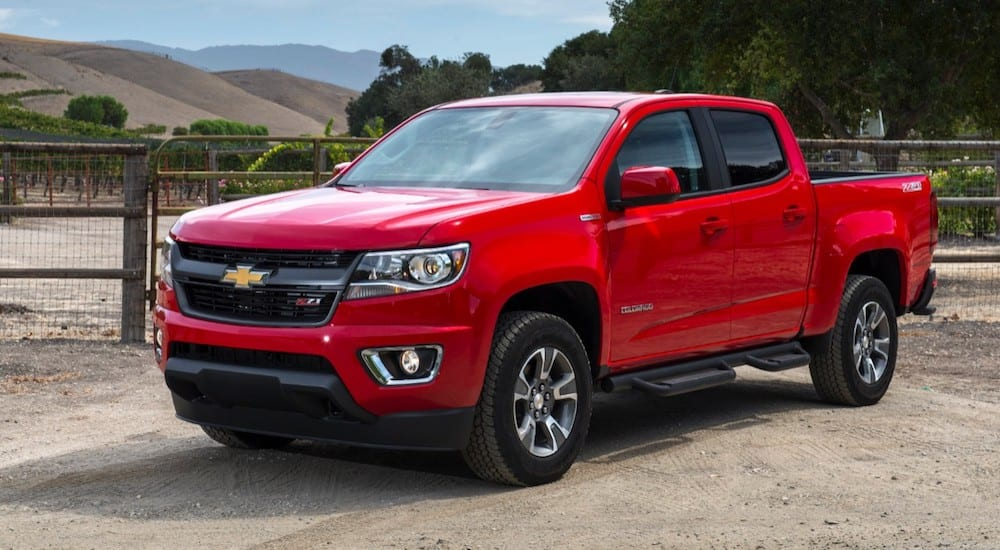 A red 2019 Chevy Colorado on a ranch, ready to work