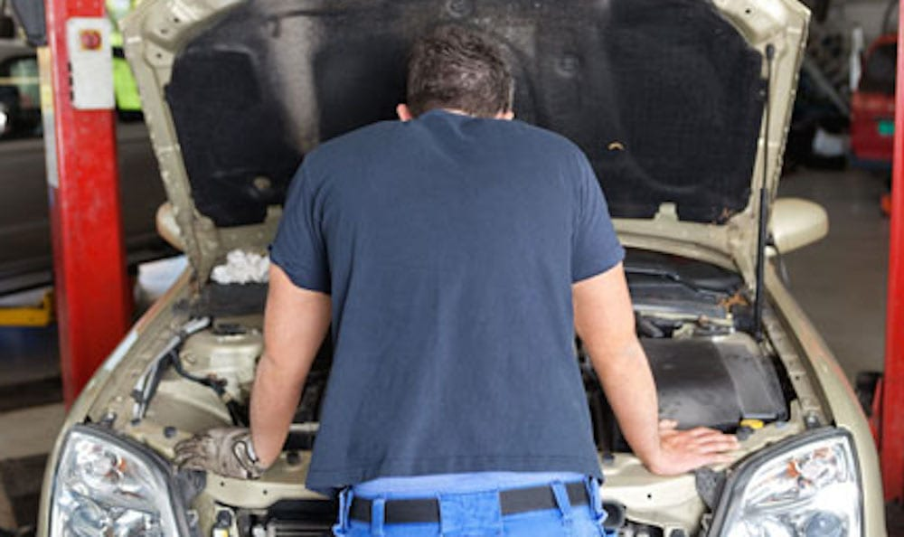 Man Looking In Engine Compartment