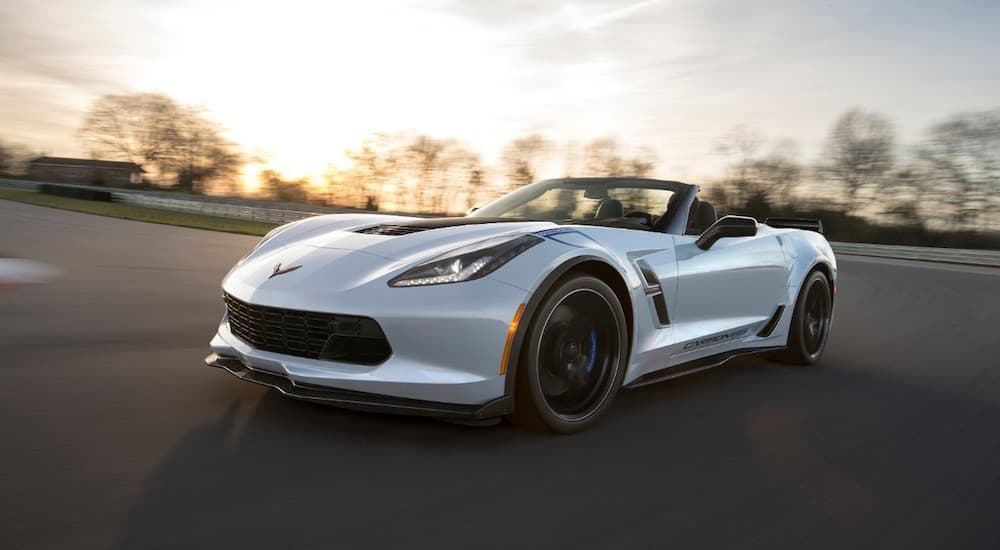 A white 2018 Chevy Corvette 65 year anniversary on a race track at sunset