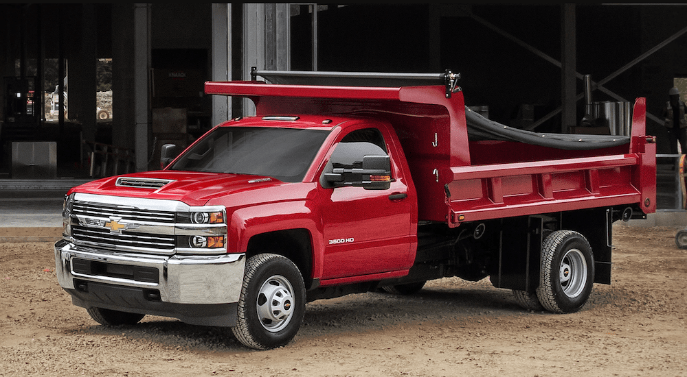 Red 2018 Chevy Silverado dump truck at construction site