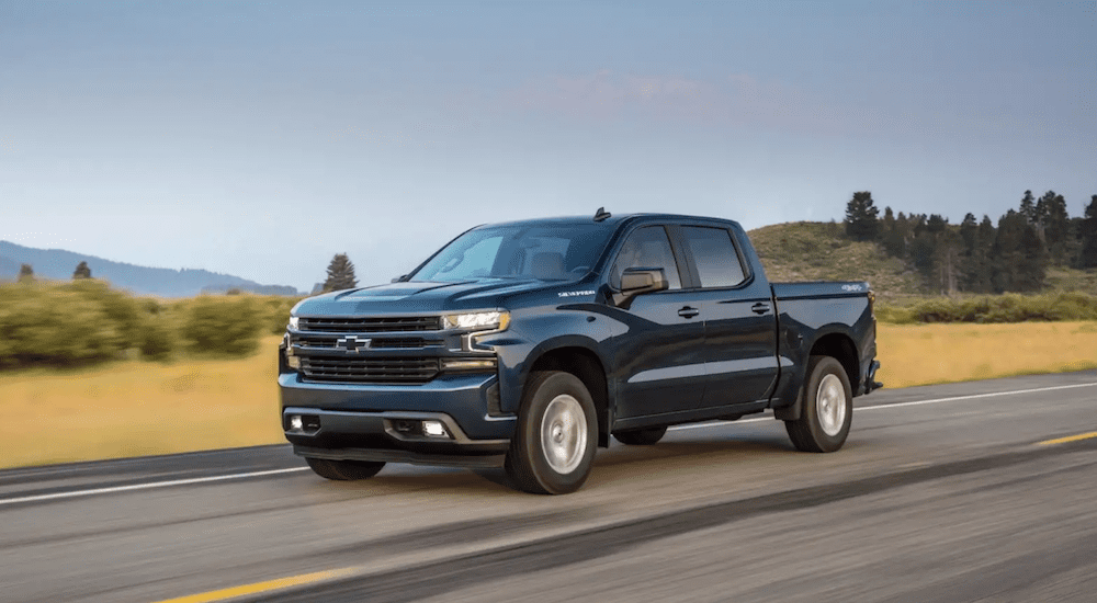 A blue 2019 Chevy Silverado 1500 goes for a test drive on the open road