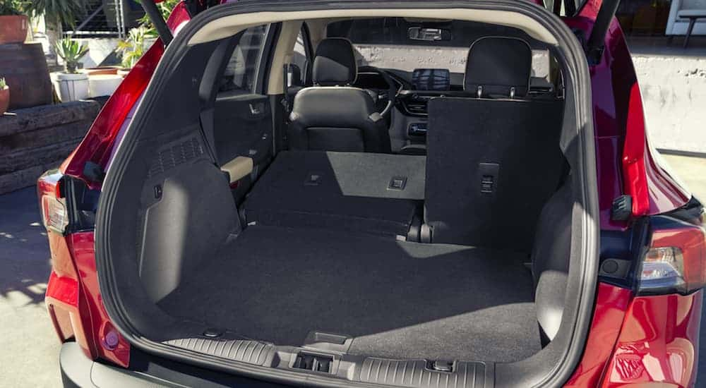 A rear to front interior look of the 2020 Ford Escape with the rear seats down is shown.