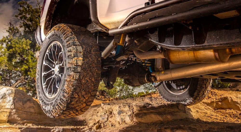 A 2018 Chevy Colorado is off-roading with upgraded wheels and off-road tires, which is a popular upgrade option among used trucks for sale.