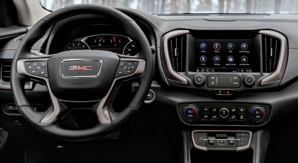 The dashboard and infotainment screen in the 2021 GMC Terrain are shown.