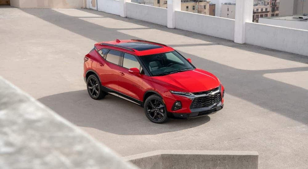 A red 2020 Chevy Blazer RS is parked in a parking garage and shown from a high angle after winning the 2020 Chevy Blazer vs 2020 Nissan Murano comparison.