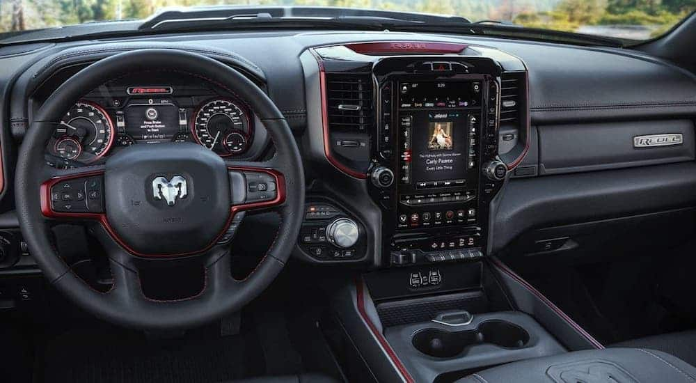 The black interior with red trim is shown in a 2020 Ram 1500 Rebel, winner of the 2020 Ram 1500 (new Ram) vs 2020 GMC Sierra 1500 comparison.
