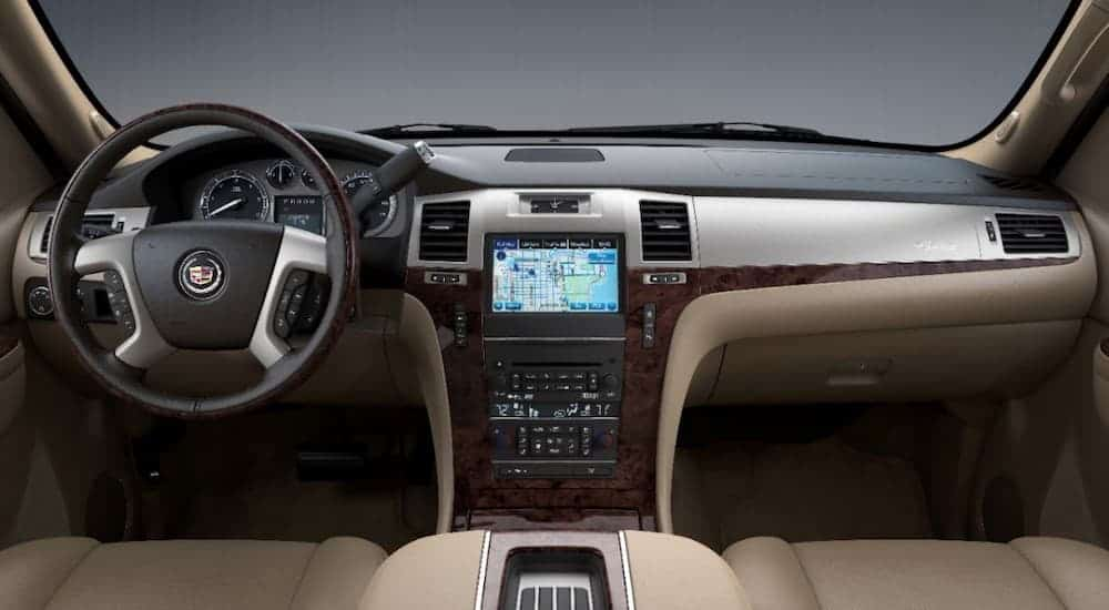 The black and tan interior is shown on a 2014 used Cadillac Escalade.