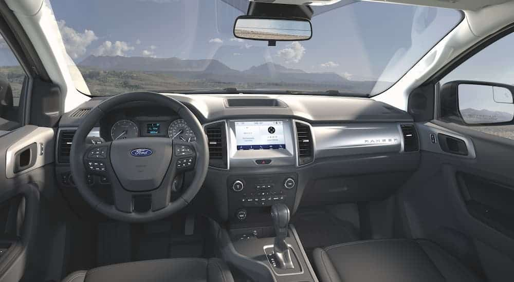 The black interior is shown on a 2021 Ford Ranger STX.