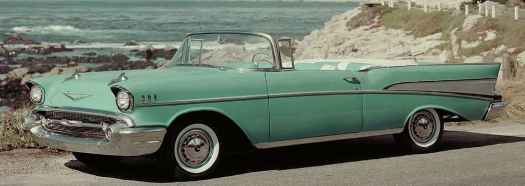 1957-Chevy-Bel_Air-Convertible-green in front of beach