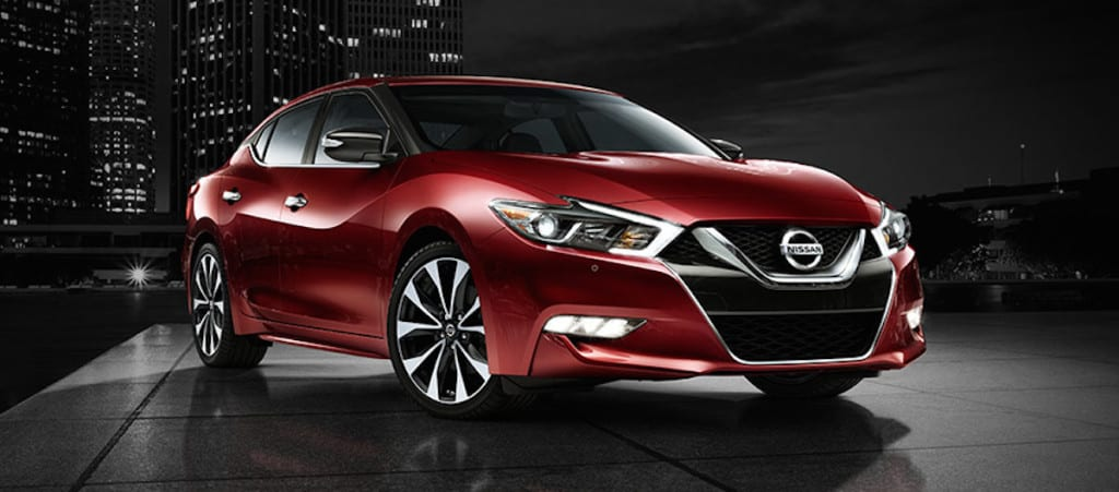 2016-nissan-maxima-coulis-red-side-view-night-skyline-next-steps