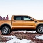 A gold 2019 Ford Ranger is on partly snowy ground.