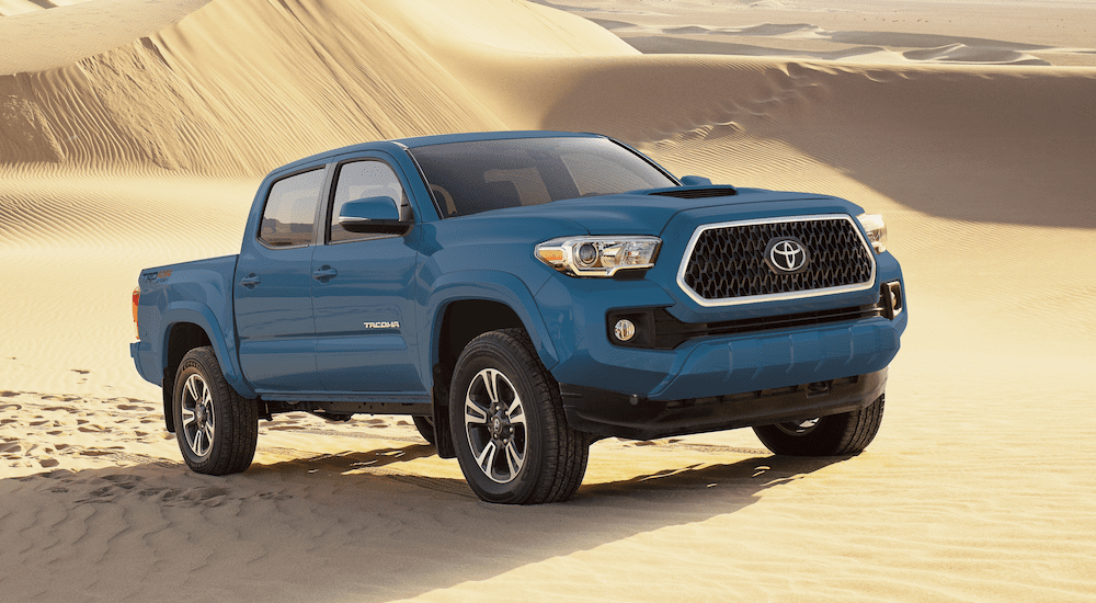 Blue 2019 Toyota Tacoma in sand dunes