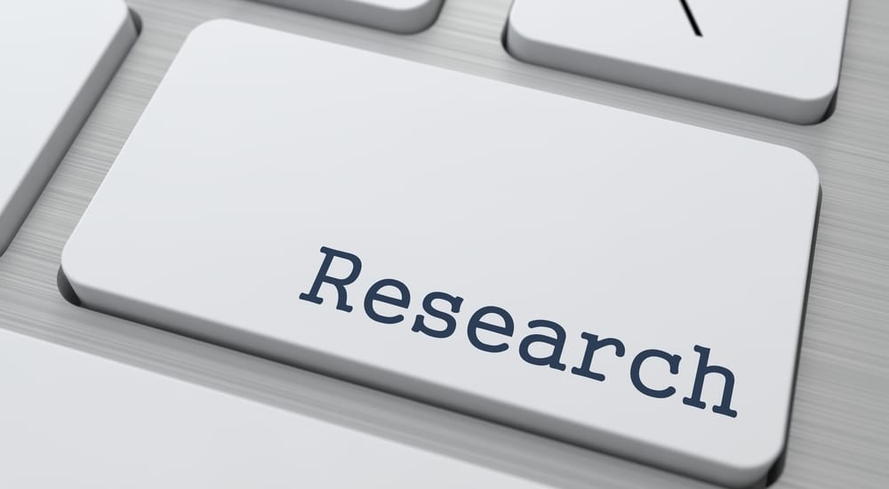 "Button on Computer Keyboard with the Word ""Research"" on It."