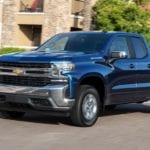 Dark blue 2019 Chevy Silverado Turbo on street