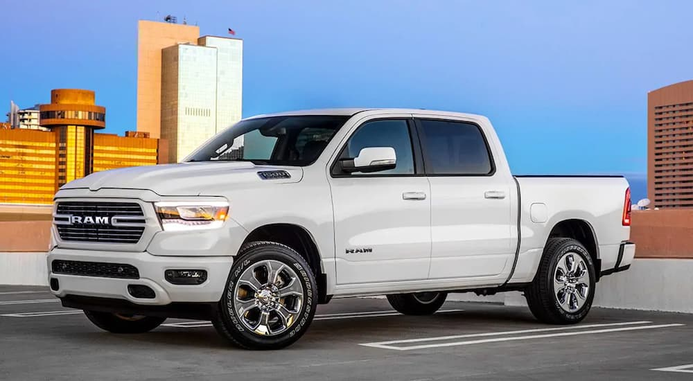 White 2019 Ram 1500 on top of parking structure in city