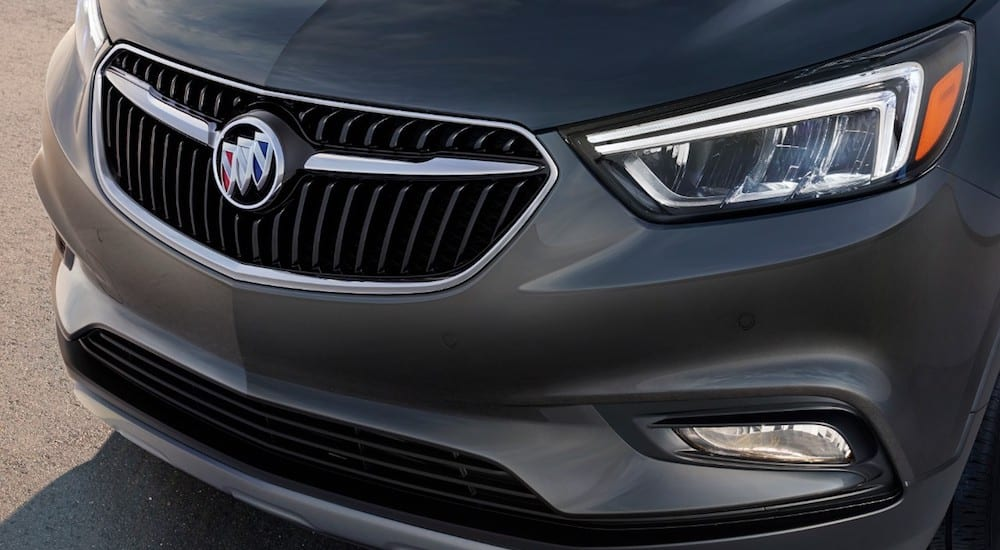 A closeup of the front end of a gray 2019 Buick Encore