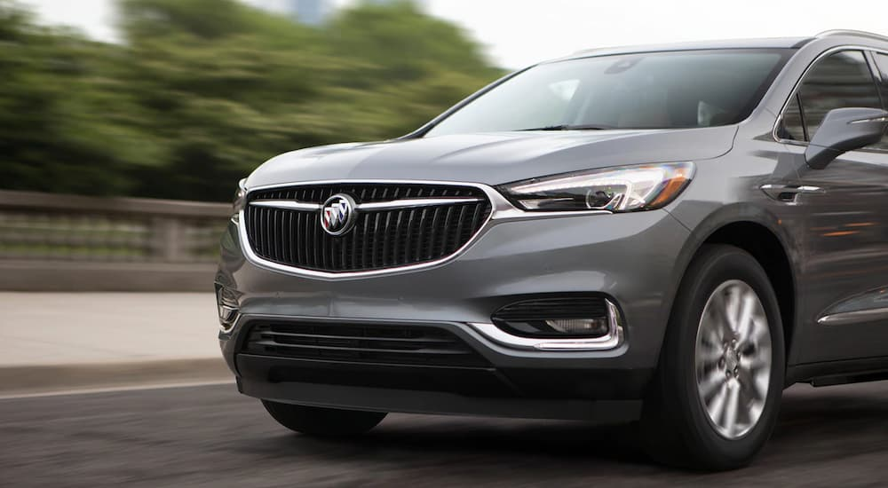 A grey 2019 Buick Enclave is shown from a front side angle driving.