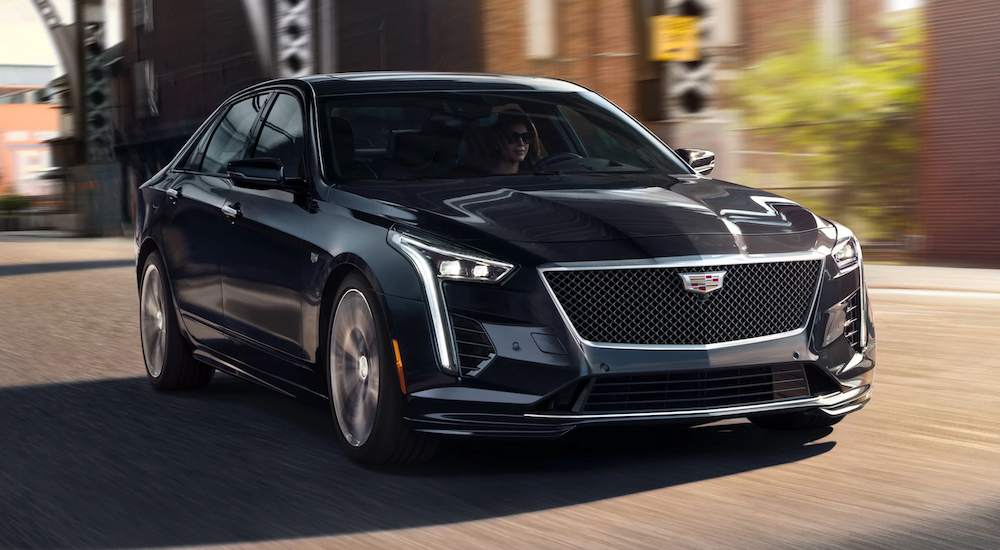 A black 2019 Cadillac CT6 is driving downtown.