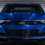A close up of the front end of a blue 2020 Chevy Camaro is shown.