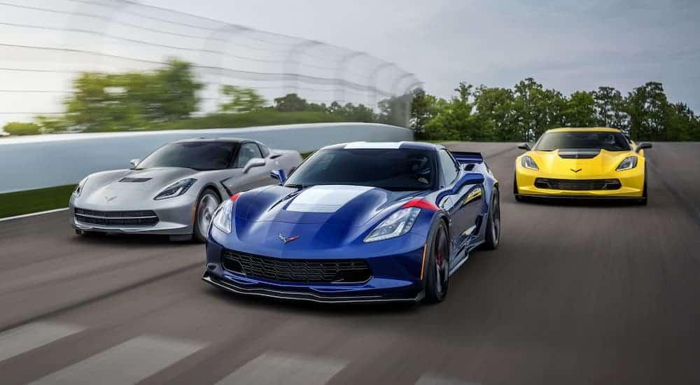 Three 2019 Chevy Corvettes are racing.