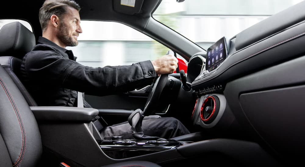 A man is shown driving his 2020 Chevy Blazer with an interior view.