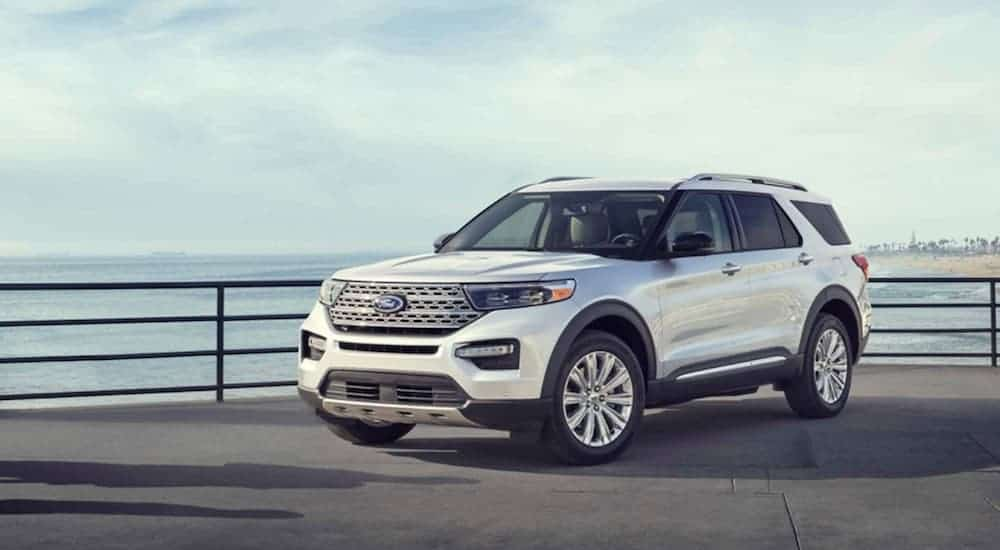 A white 2020 Ford Explorer is parked on a pier after winning the 2020 Ford Explorer vs 2020 Jeep Grand Cherokee comparison.