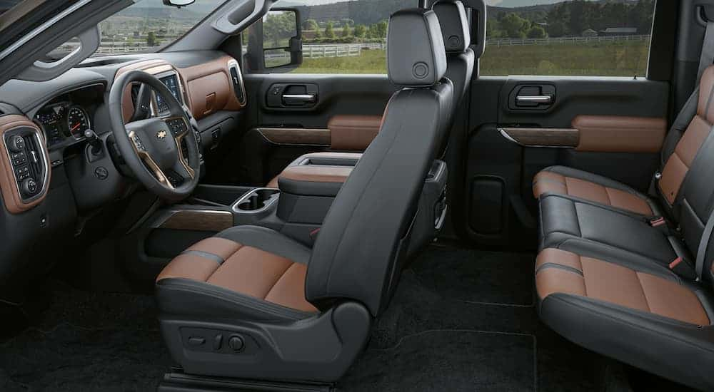 The brown and black interior of a 2020 Chevy Silverado 3500HD is shown.