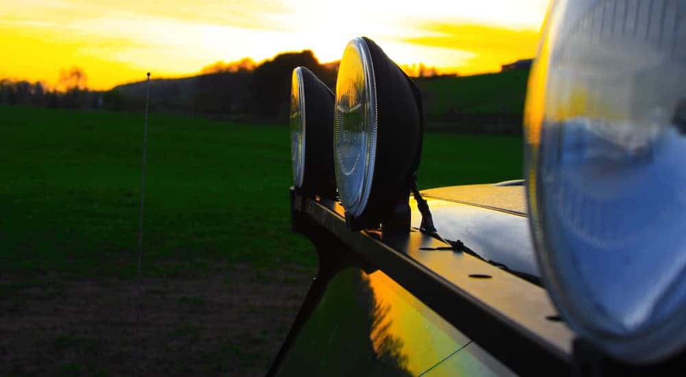 A closeup is shown of a light bar on a vehicle at sunset.