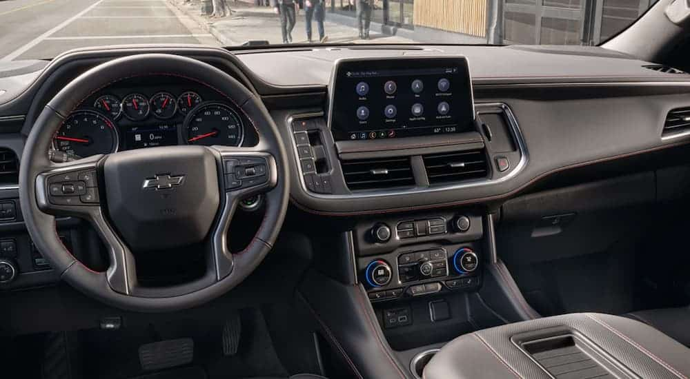 The steering wheel and infotainment screen in the 2021 Chevy Tahoe are shown.