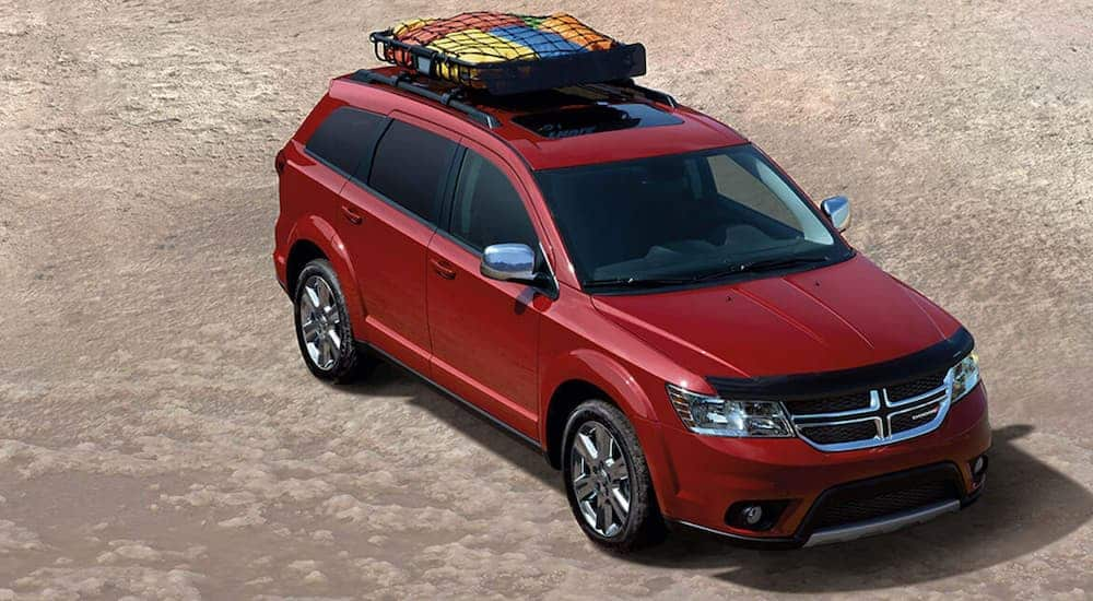A red 2020 Dodge Durango, one of the worst SUVs of all time, is shown from above in the desert.
