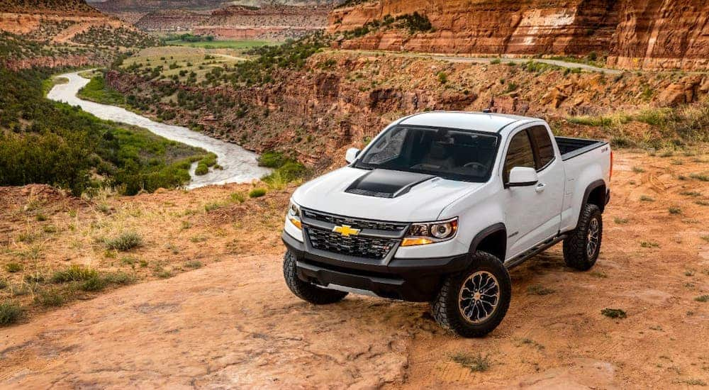 A white 2020 Chevy Colorado ZR2 is parked overlooking a canyon.