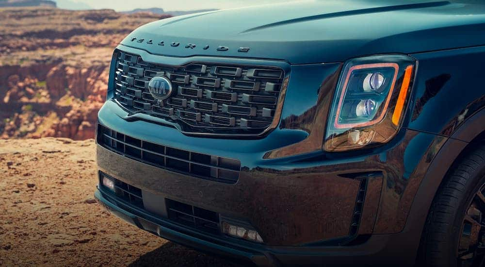 A closeup shows the grille on a green 2020 Kia Telluride.