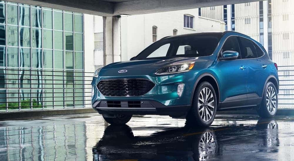 A blue 2020 Ford Escape is parked in a garage.