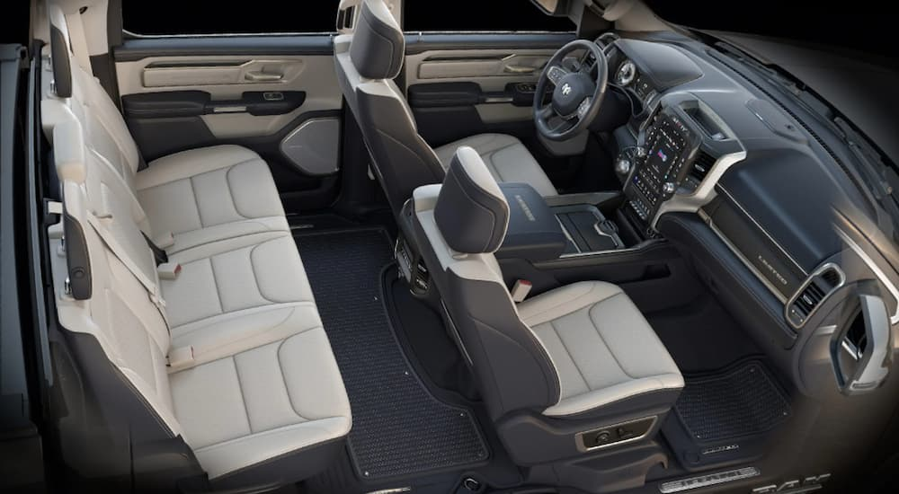 The cream and grey interior of a 2020 Ram 1500 Limited is shown.