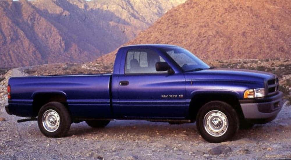 A blue 1994 Ram 1500 from a Ram dealer near you is parked in front of mountains.