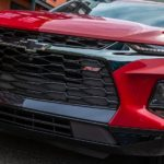 A close up of the front end on a red 2021 Chevy Blazer RS is shown.