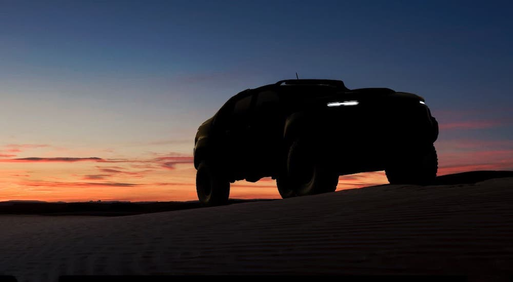A silhouette of a 2016 Chevy Colorado ZH2 concept is shown at sunset.
