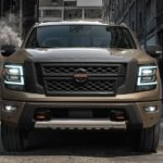 A tan 2021 Nissan Titan XD is parked in an alleyway.