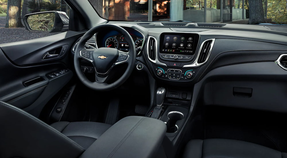 The interior of a 2021 Chevy Equinox shows the steering wheel and information screen.