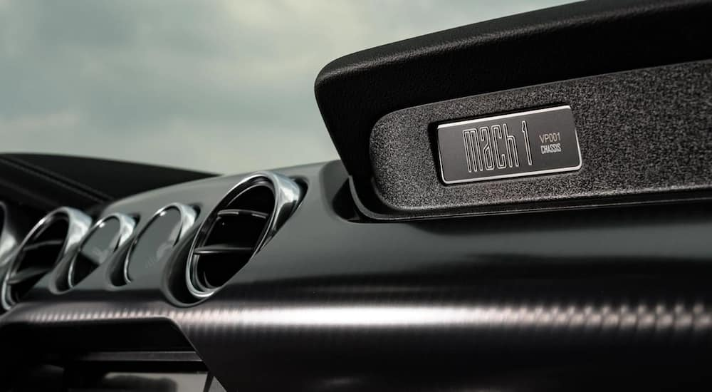 The interior of a 2021 Ford Mustang Mach 1 shows a Mach 1 emblem.