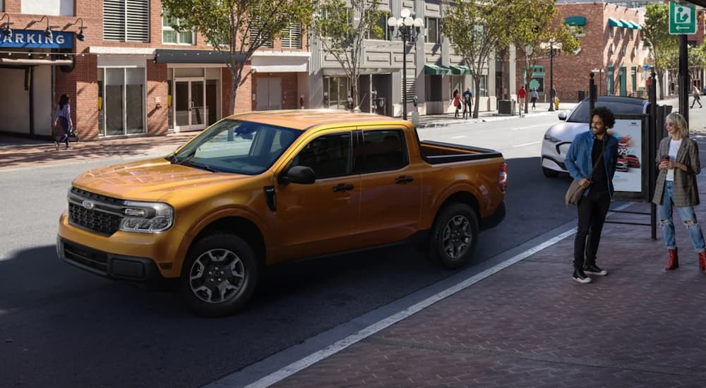 A yellow 2022 Ford Maverick is shown parked on a city street.